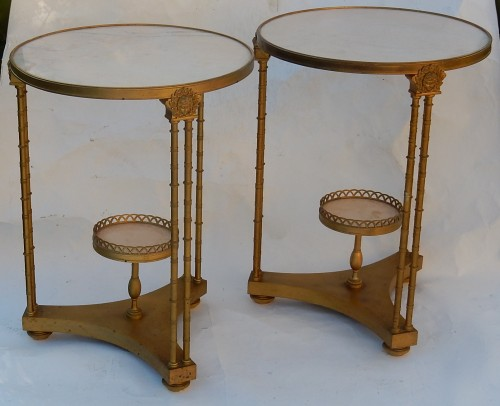 Pair of gilt bronze pedestal tables signed Jansen -