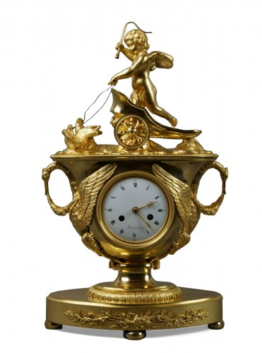 19th Century Empire period gilt bronze vase mantel clock with char of love
