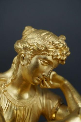 "Clocks  - Empire period clock ""La Liseuse"" Gilt Bronze"
