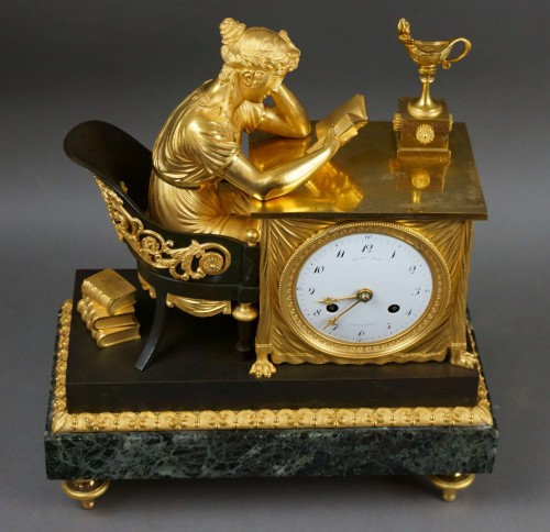 "Empire period clock ""La Liseuse"" Gilt Bronze -"