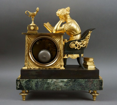 "19th century - Empire period clock ""La Liseuse"" Gilt Bronze"