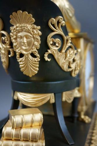 """Empire - Empire period clock """"La Liseuse"""" Gilt Bronze"""