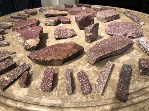 A collection of 45 ancient imperial Egyptian porphyry fragments -