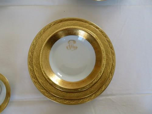 Porcelain & Faience  -  Set in Porcelaine of Limoges Thistle gold model by Chastagner