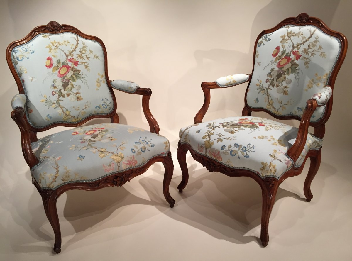 pair of french walnut armchairs lyon louis xv period by pierre