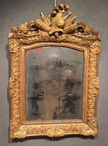 Wooden mirror gilded trophy of war, Regence period
