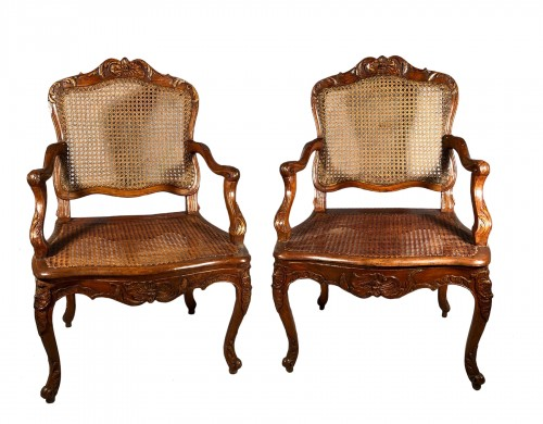 Beautiful pair of finely carved armchairs attributable to René Cresson.