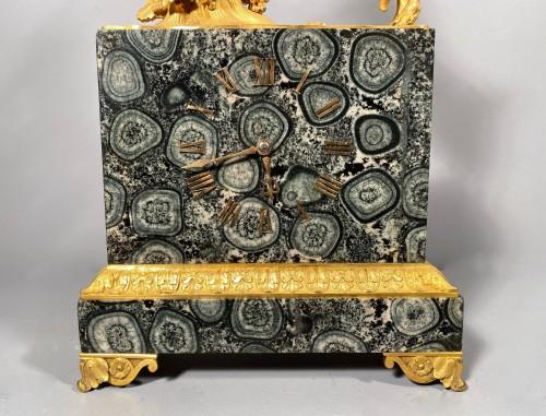 French clock in rare stone symbolizing Corsica, empire period 1815 -