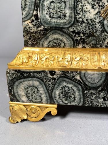 French clock in rare stone symbolizing Corsica, empire period 1815 - Empire