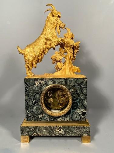 Antiquités - French clock in rare stone symbolizing Corsica, empire period 1815