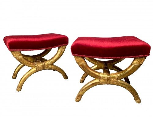 Pair of curule stools in golden wood, Paris Empire period