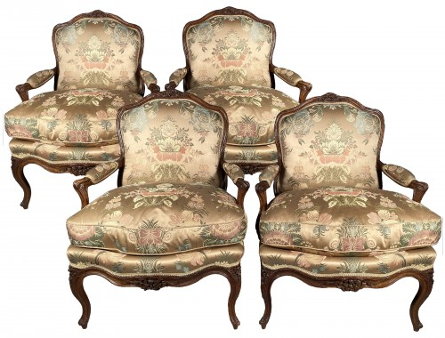 Series of four walnut armchairs by Pierre Nogaret circa 1770