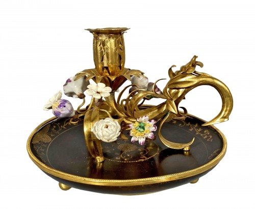 Ormolu, lacquer and porcelain toilet candlestick, Paris circa 1750.