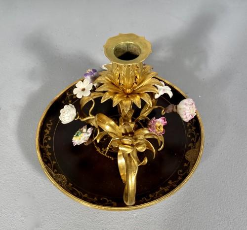Ormolu, lacquer and porcelain toilet candlestick, Paris circa 1750. -