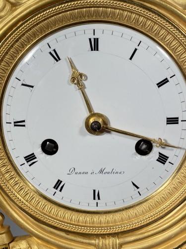 Antiquités - Joséphine harpist clock, Paris Empire period