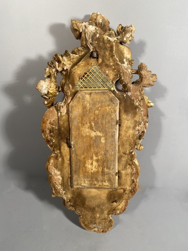 Antiquités - Cartel with carved and gilded wood, Alsace circa 1750.