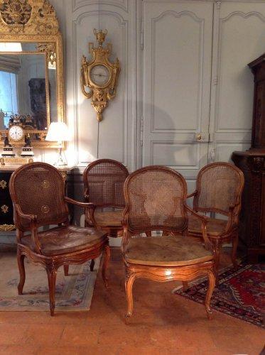 Suite de 4 fauteuils cannés par Louis DELANOIS