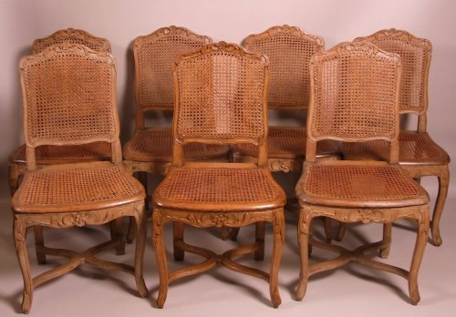 Suite of seven Regence caned chairs stamped by Amand