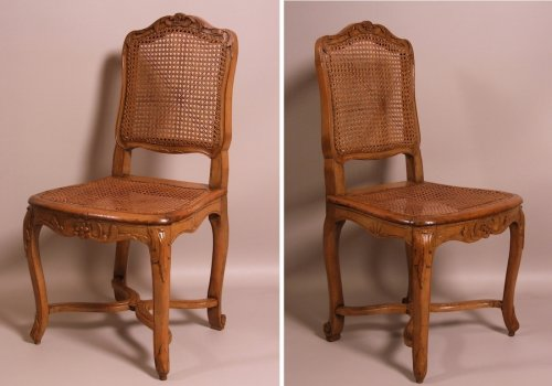 Suite of seven Regence caned chairs stamped by Amand -