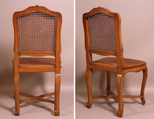 Suite of seven Regence caned chairs stamped by Amand - Louis XV
