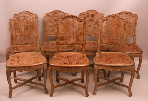 Louis XV - Suite of seven Regence caned chairs stamped by Amand