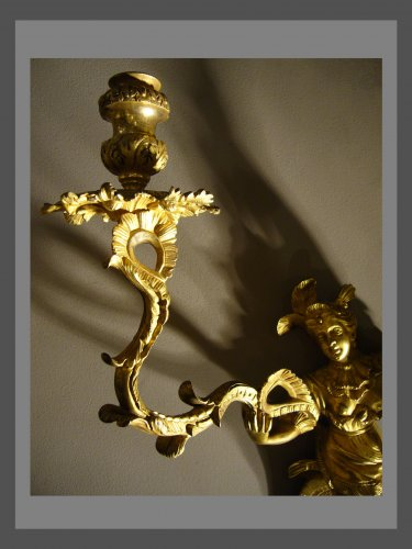 A pair of Regence ormolu two-branch firgural wall-lights -