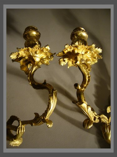 A pair of Regence ormolu two-branch firgural wall-lights - French Regence