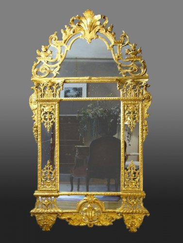 A Louis XIV carved pierced and giltwood Mirror
