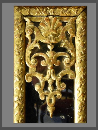 Mirrors, Trumeau  - A Louis XIV carved pierced and giltwood Mirror