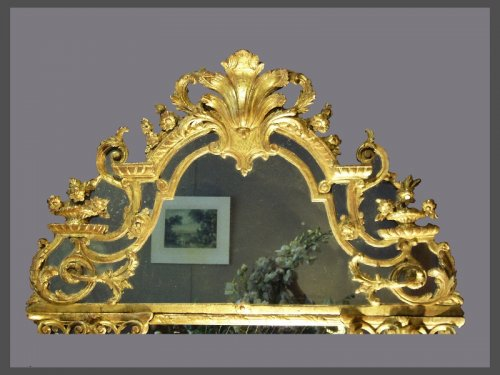 A Louis XIV carved pierced and giltwood Mirror -