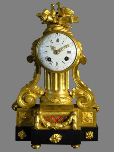 French Louis XVI period gilt-bronze and black marble mantel clock by Causard