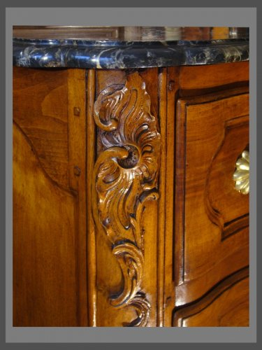 Furniture  - An exceptional crossbow shaped solid blond walnut commode.