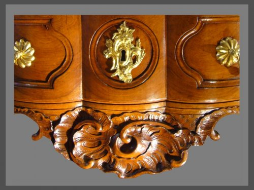 An exceptional crossbow shaped solid blond walnut commode. -
