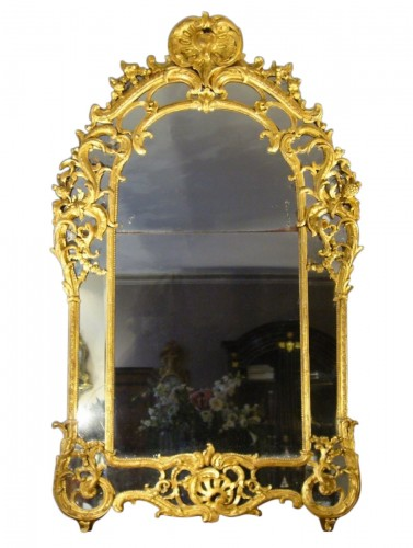 A very decorative Louis XV pierced, carved, and giltwood mirror