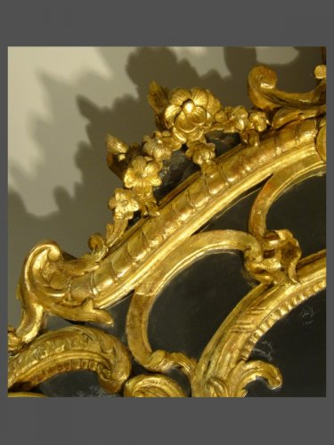 A very decorative Louis XV pierced, carved, and giltwood mirror -