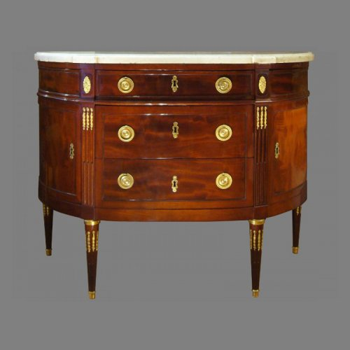 A Louis XVI ormolu-mounted Mahogany Demi-Lune Commode, by N. PETIT
