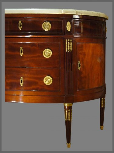 A Louis XVI ormolu-mounted Mahogany Demi-Lune Commode, by N. PETIT -