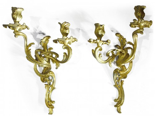 A pair of Louis XV period gilt-bronze two-branch wall-Lights