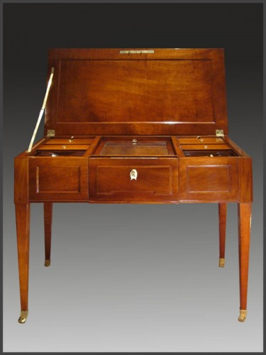Louis XVI - A Mahogany 'à combinaisons' Table
