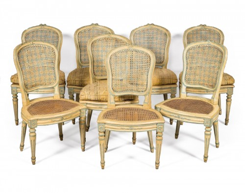 A Suite of eight Louis XV Caned Chairs