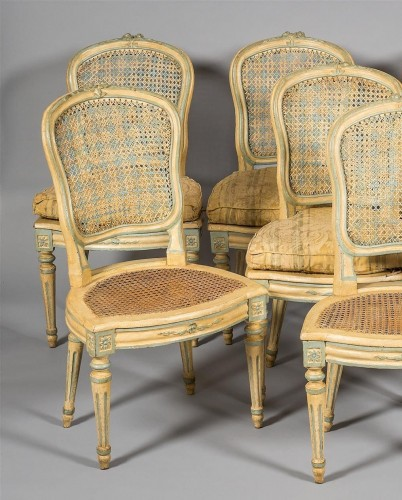 A Suite of eight Louis XV Caned Chairs -