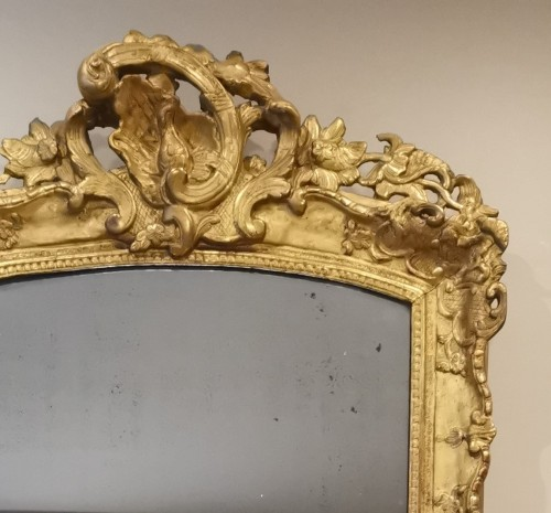 French Regence - A Late Régence Period Giltwood Mirror, early 18th century