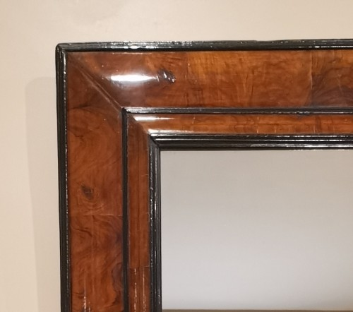 A Louis XIV walnut cushion-framed mirror  late 17th century, circa 1680. -