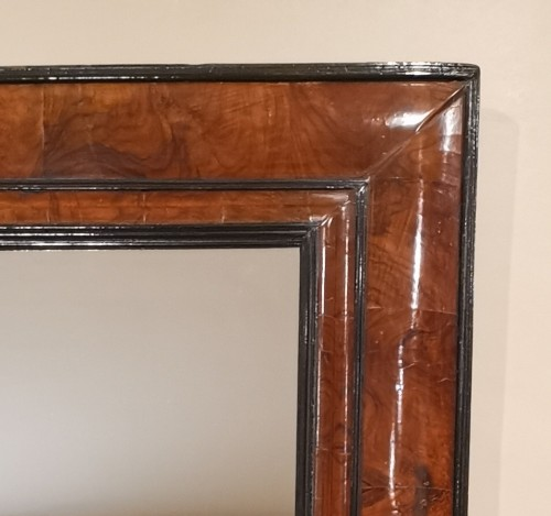 17th century - A Louis XIV walnut cushion-framed mirror  late 17th century, circa 1680.
