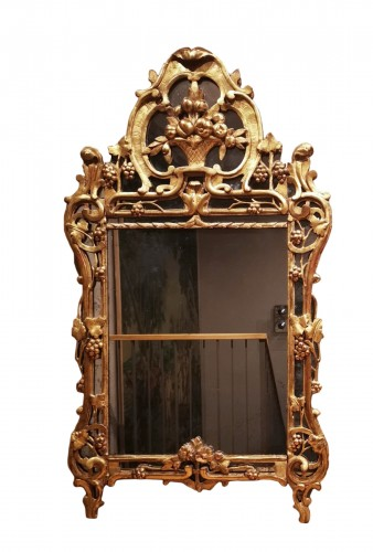 A Louis XV giltwood mirror from Provence
