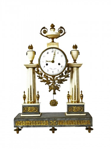 A Louis XVI portico marble and gilt-bronze mantel clock.