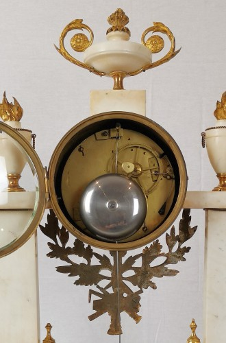 A Louis XVI portico marble and gilt-bronze mantel clock. -