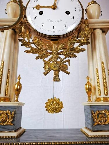 A Louis XVI portico marble and gilt-bronze mantel clock. - Louis XVI