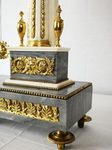Louis XVI - A Louis XVI portico marble and gilt-bronze mantel clock.