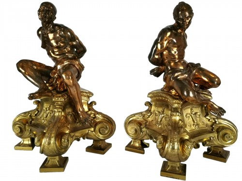 A pair of gilt-bronze slaves fire dogs, after a model by Pietro Tacca